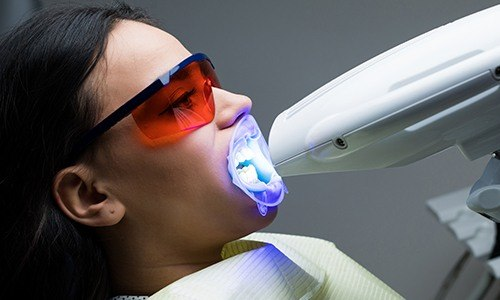 Patient receiving teeth whitening treatment