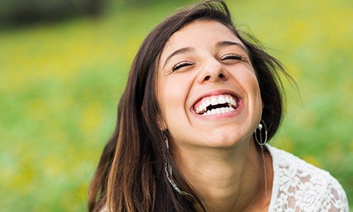 Laughing woman outdoors