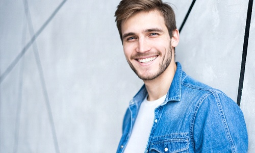 Man with attractive smile after gum contouring.