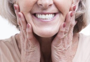 close up of elderly woman smiling with dentures in Worcester
