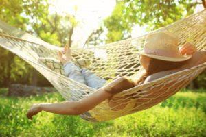 Woman relaxing in hammock after wisdom teeth removal
